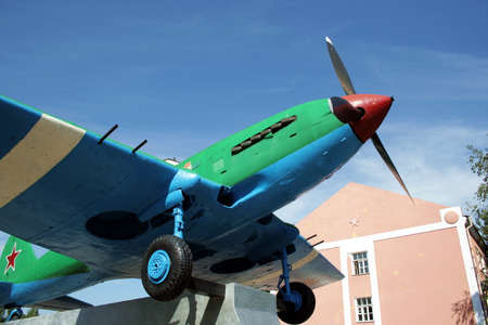 airborne vehicle: Historical monument. Propeller-driven war-plane.