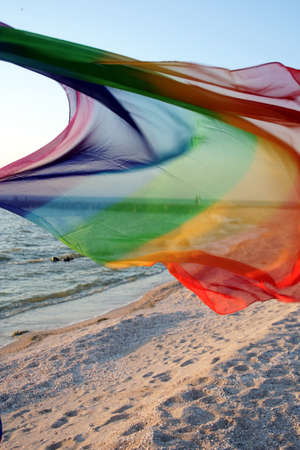 pellucid: Wind on the beach. Colored mantlet  Stock Photo