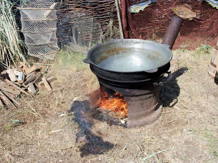 toils: Cossack village. Preparation of the fish-soup in caldron 2