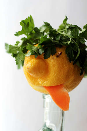 jesting: Humorous face prepared from lemon and greens 2