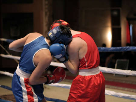 Two boxer. Fighting on boxing ring photo