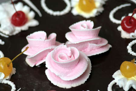 bacca: rose cream flowers on the chocolates cake Stock Photo