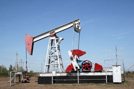 Industrial construction and mechanism. Oil pump jack. photo