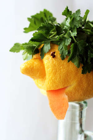 drollery: Humorous face prepared from lemon and greens