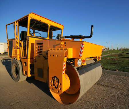 Orange road-roller on repairing of the road photo
