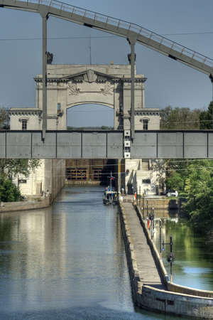 sluice on the Volga-Don canal and railway  bridge Banco de Imagens