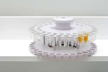 biochemical laboratory. Calibrations carrousel for the biochemical analyzer Stock Photo