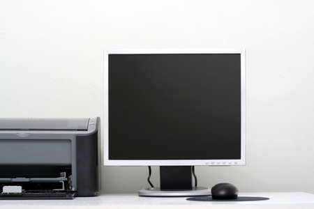 LCD monitor, jet printer and the mouse on a workplace Stock Photo