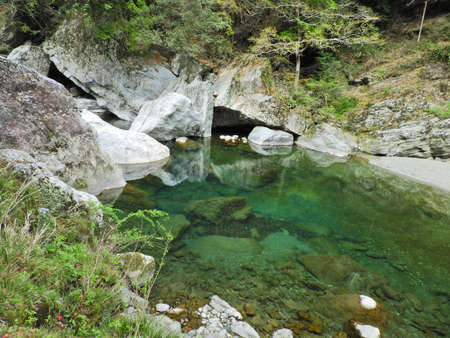 A mountain stream with a clear view of the bottom of the river