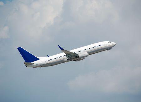 Modern passenger jet in flight Stock Photo