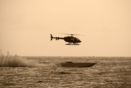 piloting: Helicopter chasing speedboat