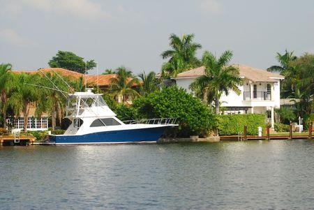 Luxury waterfront home with boat dock Reklamní fotografie