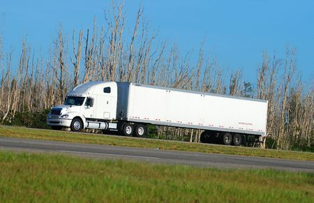 Heavy white truck on the road photo