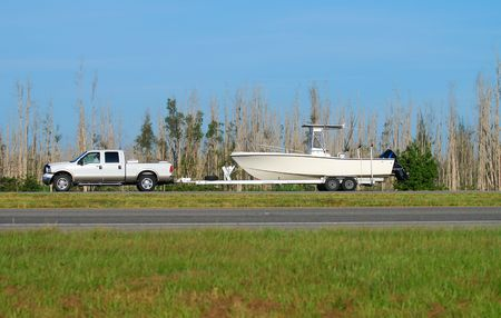 trailer: Truck towing boat Stock Photo