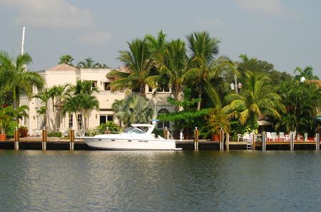 Waterfront home with yacht photo