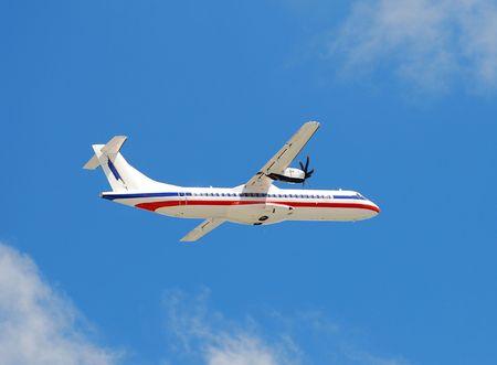 turboprop: Modern turboprop airplane in flight