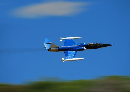 airborne vehicle: Jet fighter plane with speed blur