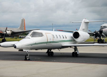 Private jet parked at airport Banco de Imagens