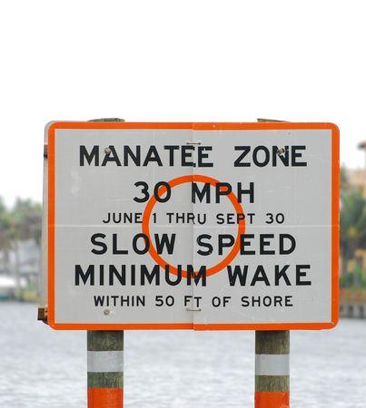 Warning sign to protect Florida manatees photo