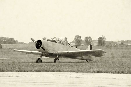 wartime: Artificially aged photo of wartime airplane