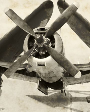 Aged photograph of historic WWII aircraft with folded wings