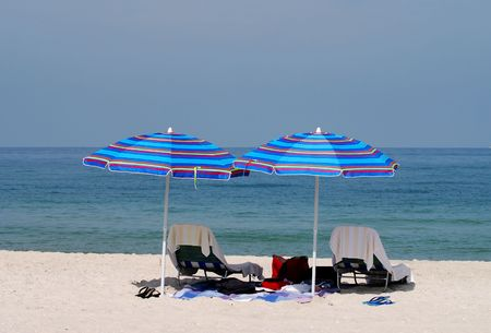 memorable: Empty beach lounge chairs