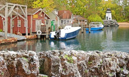 Boats docked in harbor of northeastern fishing village