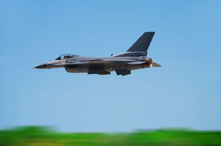 airborne vehicle: Fighter jet in flight with motion blur