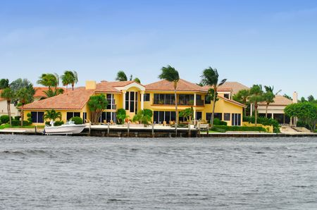 Expensive coastal mansion photo