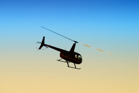 Helicopter departing at dawn