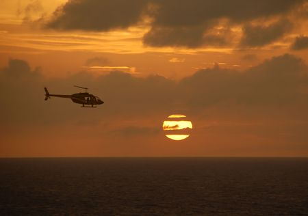 Helicopter by sunset photo