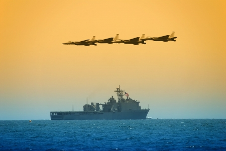 superiority: Jetfighters flying over navy carrier