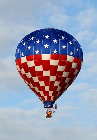 Hot air baloon in flight with the American flag colors              Stock Photo