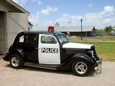 Gangster style police car from the 30s (Americana)                       photo