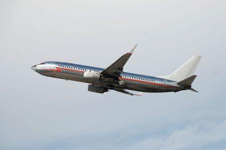 Retro style siver jet taking off                          Stock Photo