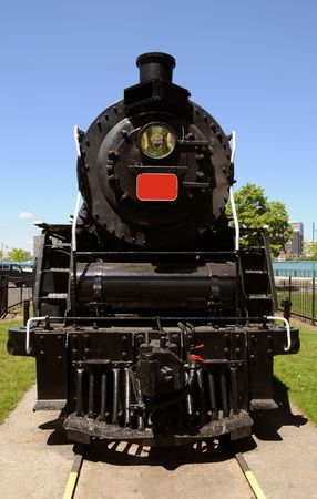 front of: Front view of black classic steam engine                Stock Photo