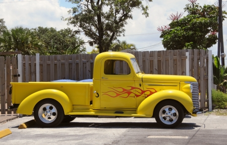 pickup: Small pickup truck with bright yellow color                              Stock Photo