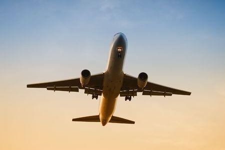 jetliner: jetliner approaching at dawn          Stock Photo