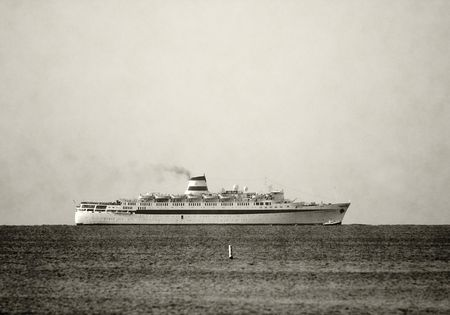 Duotone vintage ocean liner on the horizon                          Stock Photo