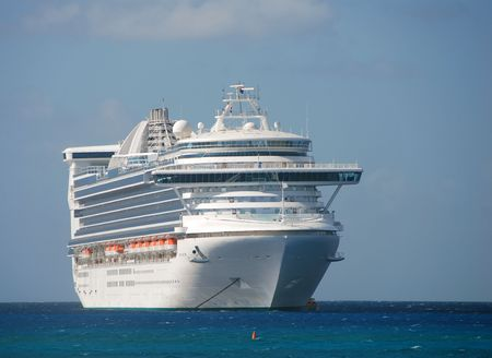 Large white cruise ship visiting port              Stock Photo