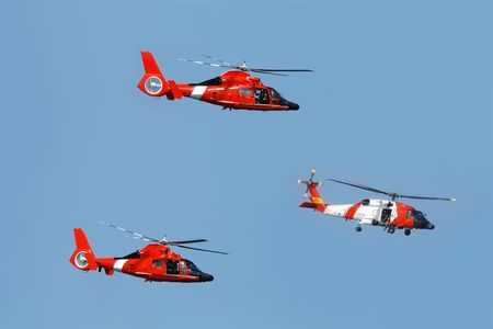 Three helicopter patrolling on a coast guard mission