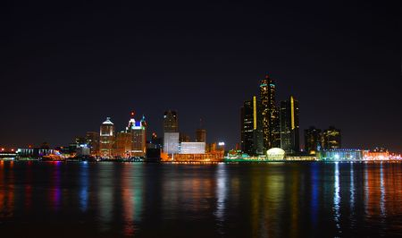 City skyline and lights with water reflection (Detroit)                    Stock Photo