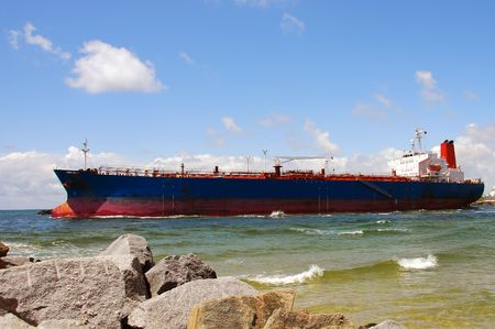 departing: Heavy cargo ship leaving a Florida port                            Stock Photo