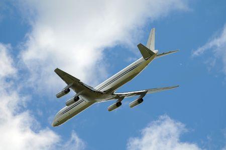 quad: Quad engine jet airplane with landing gear up