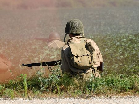 era: World War II era soldier in a cross fire
