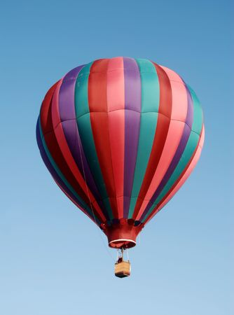 airborne vehicle: Colorful hot air balloon floating in blue sky