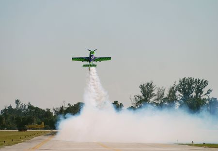 Spectacular takeoff by skilled aerobatic pilot Stock Photo