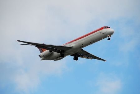 airborne vehicle: Modern jet airplane descending for landing Stock Photo