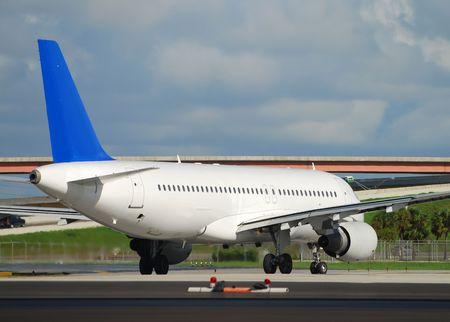 Rear view image of departing passenger jet Stock Photo