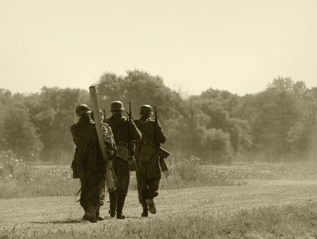 marching: World War II era soldiers on a country road